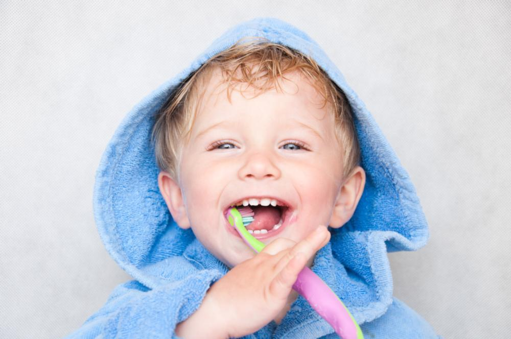 Small child holding tooth brush | Dentist Barrie ON