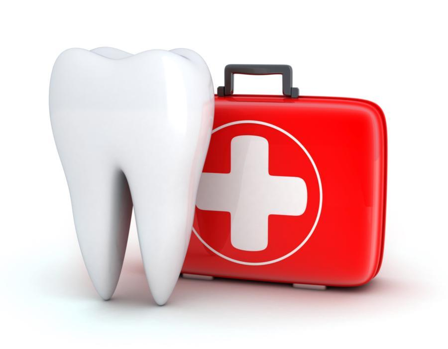 Illustrated tooth next to first aid kit | Dentist Barrie ON