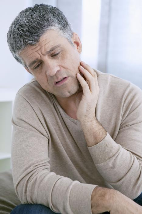 Man holding jaw from pain | dentist Barrie ON