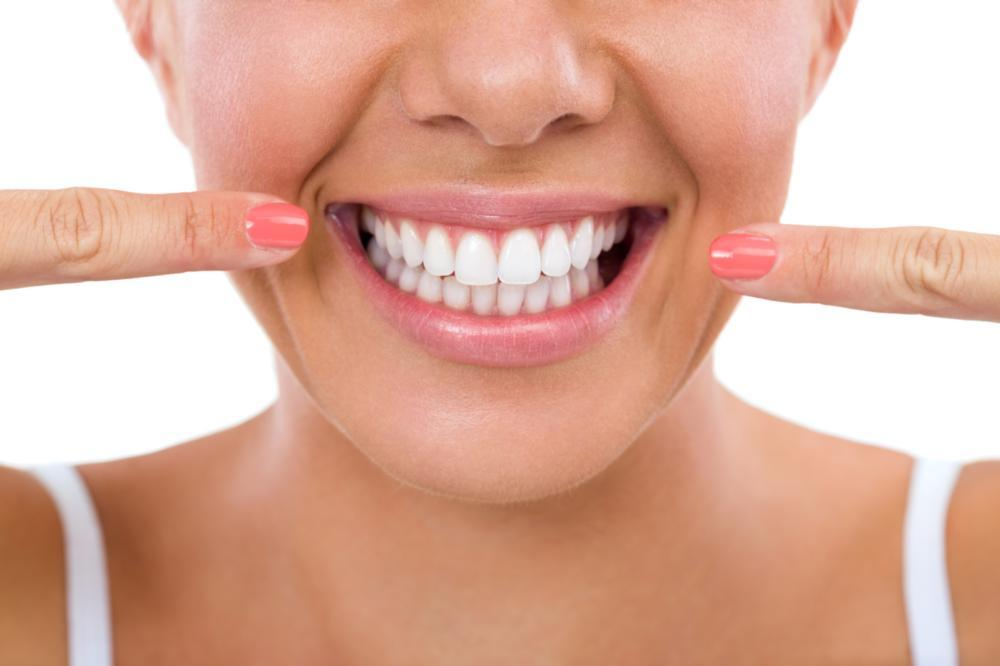 Woman Pointing to Smile | Dentist Barrie ON