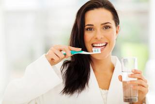 Woman Brushing Teeth | Barrie ON Dentist