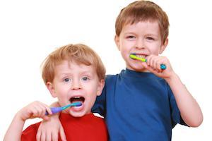 Two young boys brushing teeth | Dentist Barrie ON