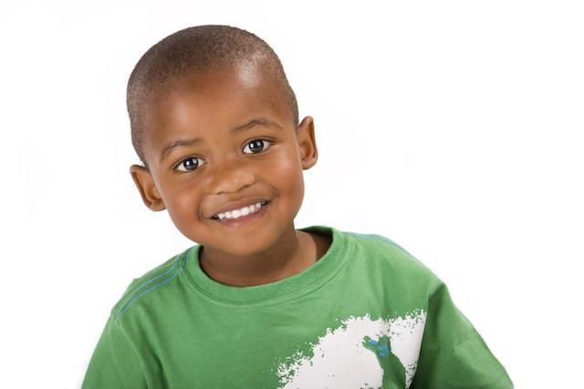 Young boy in green shirt smiling | Dentist Barrie ON