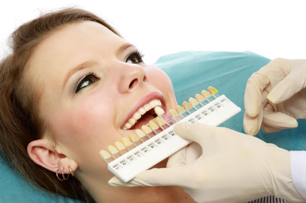 Woman getting teeth whitened | Dentist Barrie ON