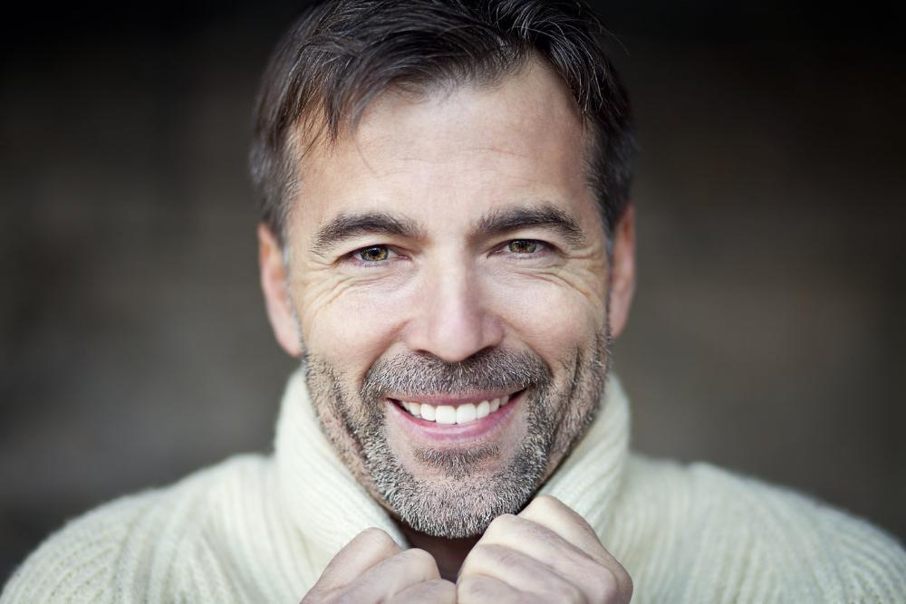 man in white sweater smiling | Dentist Barrie ON