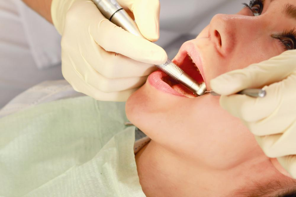 Woman getting gum treatment | Dentist Barrie ON