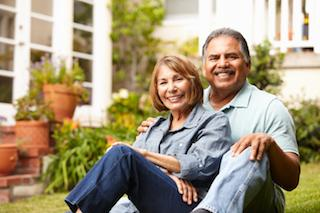 Older couple sitting outside | Dental Implants in Barrie ON