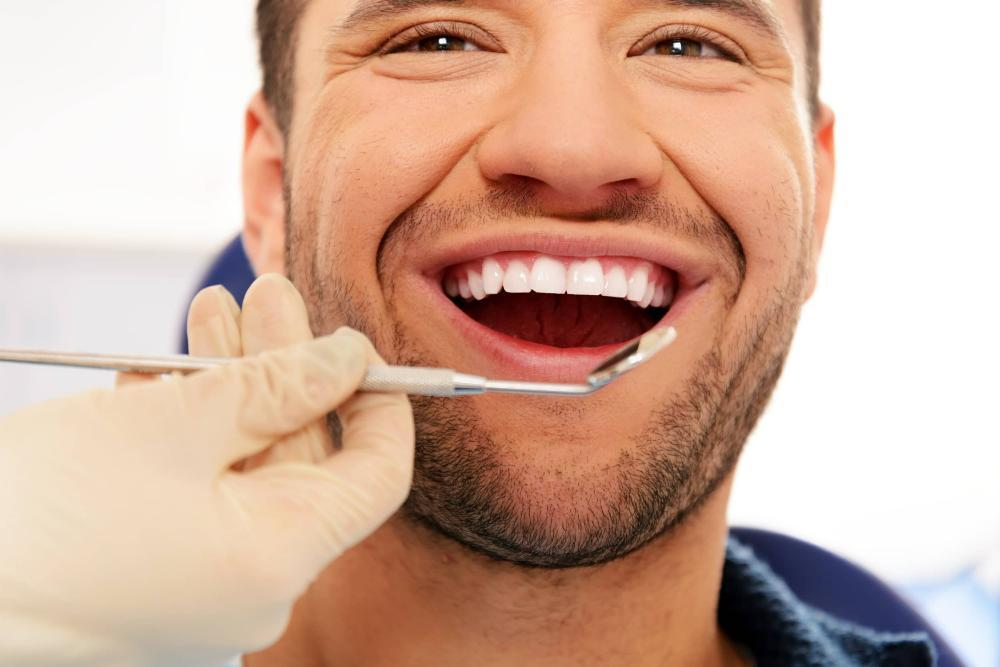 man smiling during dental exam