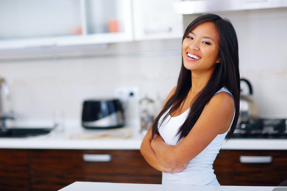 Woman smiling in kitchen | Dentist Barrie ON