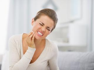 Woman suffering from toothache | Dentist Barrie ON