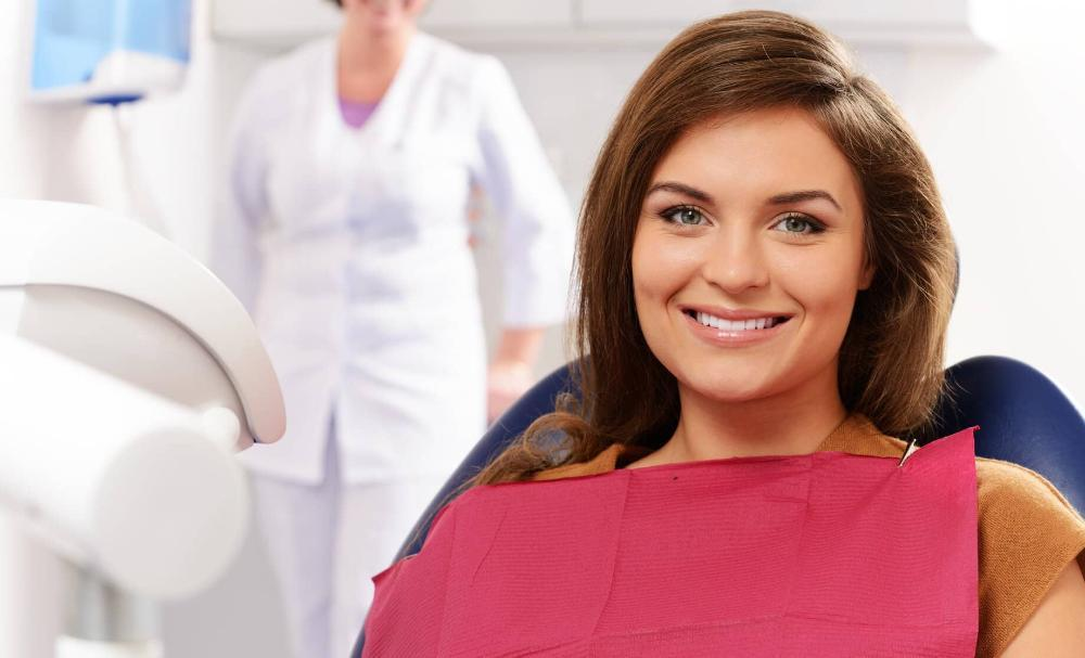 woman sitting comfortably in dental chair
