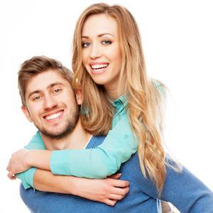 Man and woman hugging with white teeth