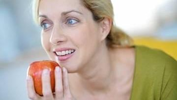 Woman Eating Apple | Dentistry in Barrie ON