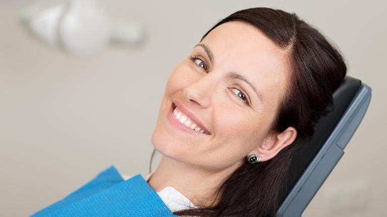 Woman smiling in dental chair | Dentist Barrie ON