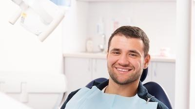 Man sitting in dental chair smiling | Dentist Barrie ON