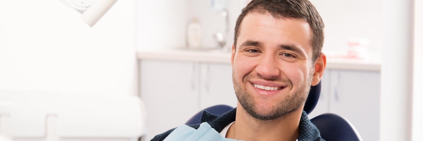 Man smiling in dental chair | Dentist Barrie ON